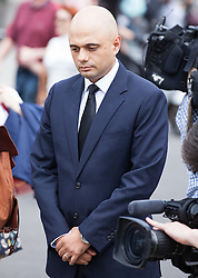 © Licensed to London News Pictures. 17/06/2016. London, UK. SAJID JAVID MP, Secretary of State for Business, Innovation and Skills, lays a bouquet of flowers in Parliament Square in tribute to Jo Cox MP, who died on 16 June 2016 after being shot and stabbed in Birstall, Leeds. Photo credit: Rob Pinney/LNP