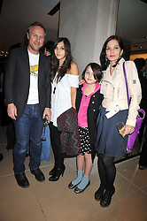SIMON & YASMIN MILLS with their daughters LAUREN & MADDIE at a party hosted by TOD's to celebrate the launch of the J.P.Loafer collection, held at the TOD's Boutique, 2-5 Old Bond Street, London on 31st March 2009.