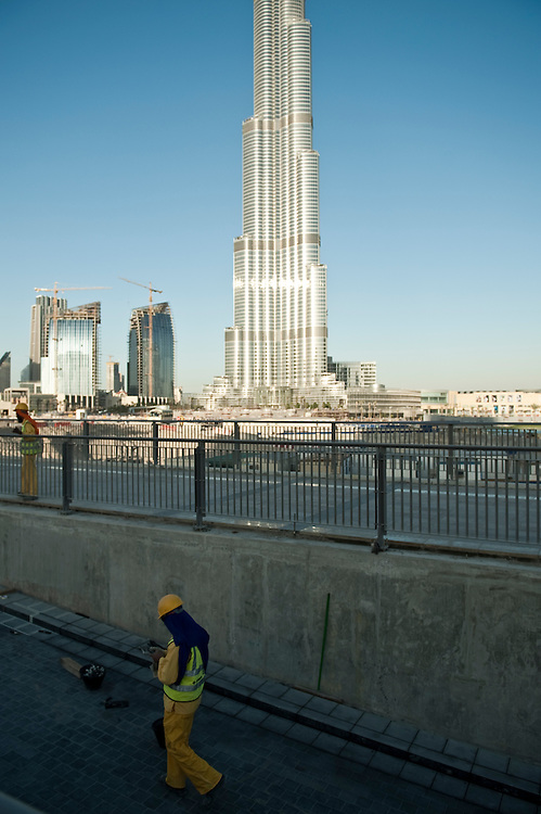 A construction worker in front of the Burj Khalifa inDubai, UAE on February 10, 2010 Archive of images of Dubai by Dubai photographer Siddharth Siva