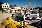 Greece, Ionian Islands, Cepalonia Island (Kefalonia), Fiskardo, Fishing boats in harbor.