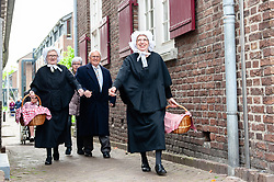 April 27, 2018 - Boxtel, Netherlands - April 27th, Boxtel. Every King's Day the giant ''Jas de Keistamper'' and his girlfriend the giantess ''Hanne mi de moor'' appear at the market place in Boxtel. Jas is more than 11 feet tall. There is no other giant in The Netherlands whose heavy body and head are carried by a strong man. In 1393, Boxtel was the only place in Noord-Brabant to have a paved road. This was part of the connection between 's-Hertogenbosch, Boxtel, Eindhoven and Liege. All the boulders had to be tamped with a boulder rammer and this required giant force. As a result of this legend, in 1949 during the reconstruction, the giant Jas de Keistamper was born. He is the personification of the cobblestone profession and symbolizes the perseverance of Boxtelaren and Boxtel's drive. (Credit Image: © Romy Arroyo Fernandez/NurPhoto via ZUMA Press)