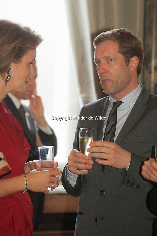 2012-01-12, Brussels, Belgium. The Belgian Royal family gave a newyears drink in the palace for all ambassadors. In this picture: Princess Mathilde with Paul Mangette, a politician.