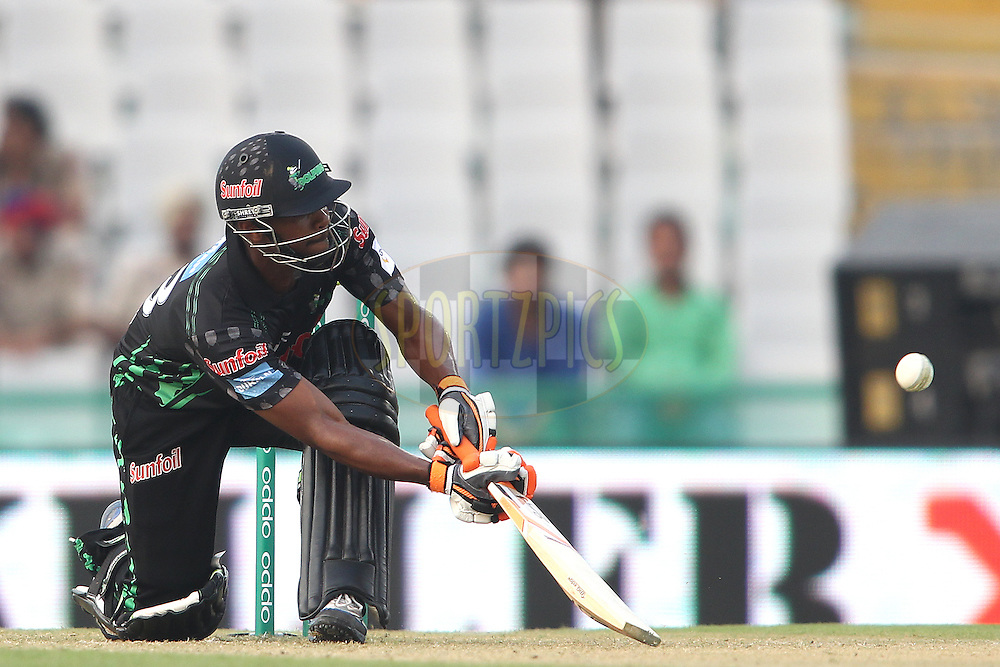Khayelihle Zondo of the Dolphins miss times his scoop shot during match 4 of the Oppo Champions League Twenty20 between the Dolphins and the Perth Scorchers held at the Punjab Cricket Association Stadium, Mohali, India on the 20th September 2014<br /> <br /> Photo by:  Shaun Roy / Sportzpics/ CLT20<br /> <br /> <br /> Image use is subject to the terms and conditions as laid out by the BCCI/ CLT20.  The terms and conditions can be downloaded here:<br /> <br /> http://sportzpics.photoshelter.com/gallery/CLT20-Image-Terms-and-Conditions-2014/G0000IfNJn535VPU/C0000QhhKadWcjYs
