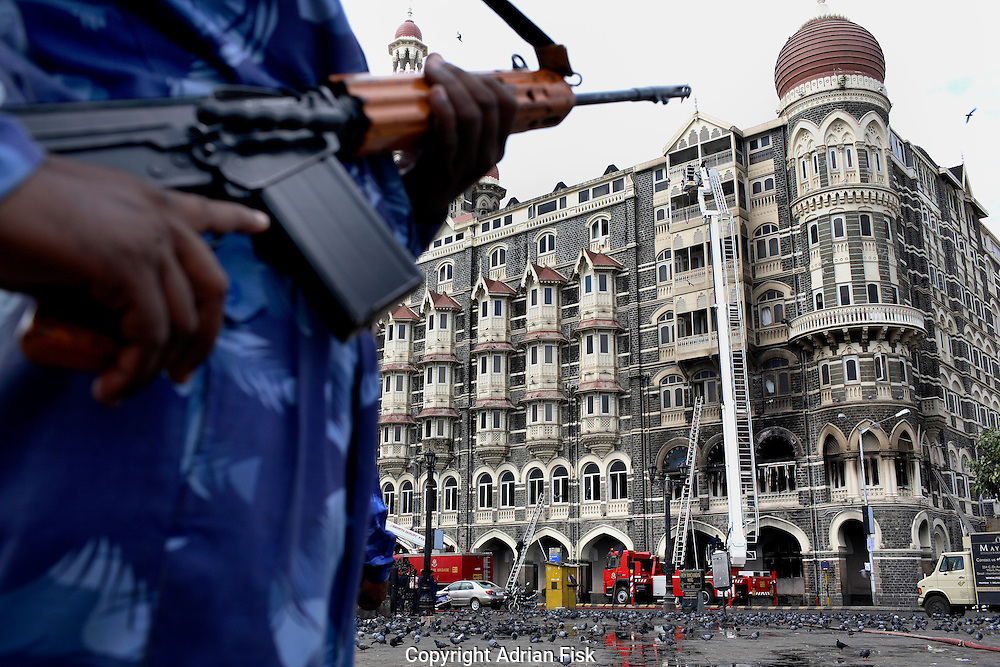 Saturday morn hours after the seige at the Taj ended rapid action force men keep a watchful eye.