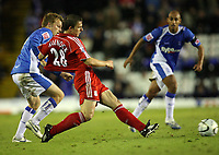 Photo: Rich Eaton.<br /> <br /> Birmingham City v Liverpool. Carling Cup. 08/11/2006. Stephen Warnock right of Liverpool has his shirt pulled by Sebastian Larsson of Birmingham