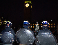 Riot police outside Houses of parliament during student protest at Christmas time