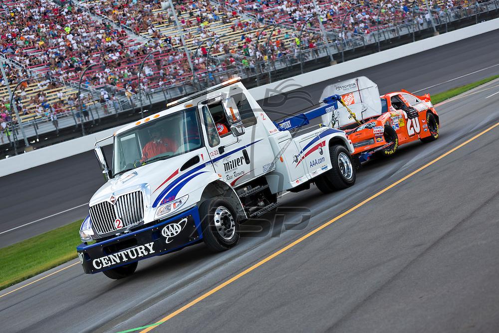 BROOKLYN, MI - JUN 17, 2012:  Joey Logano (20) races in the Quicken Loans 400 at the Michigan International Speedway in Brooklyn, MI.