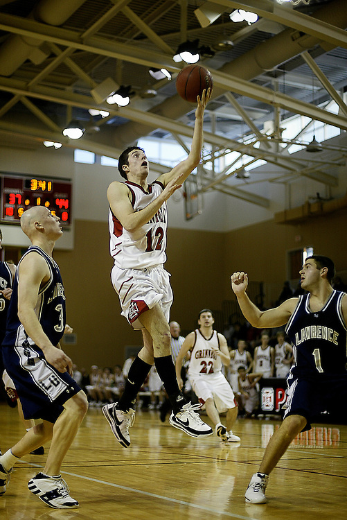 John Grotberg '09 drives in for a layup against Lawrence during the recent game in Darby Gymnasium.