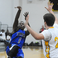 Trask's Tynaffi Davis shoots while falling down over Topsail's Xander Hunt Friday December 5, 2014 at Topsail High School in Hampstead, N.C. (Jason A. Frizzelle)