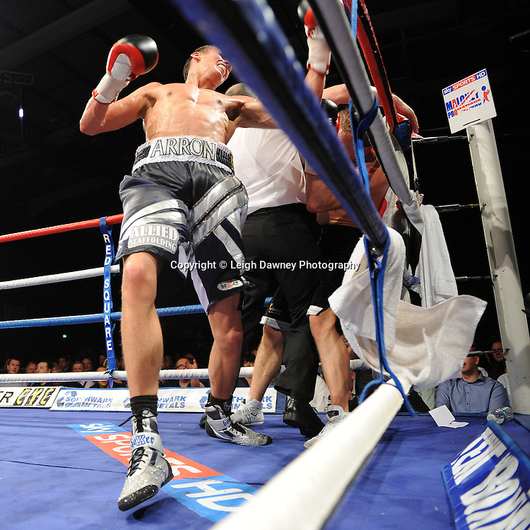 Sam Webb's corner throw in the towel stopping the fight as Prince Arron (silver/blue shorts) defeats Sam Webb claiming the British Light middleweight title at Medway Park, Gillingham,13th May 2011. Frank Maloney Promotions. Photo credit © Leigh Dawney.