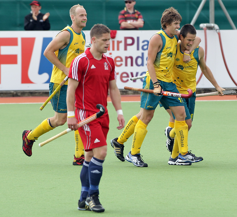 Australia's Edward Ockenden and Matthew Gohdes celebrate a goal against Great Britain in a pool A match of the Hockey Champions Trophy, Auckland, New Zealand, Monday, December 05, 2011.  Credit:SNPA / David Rowland