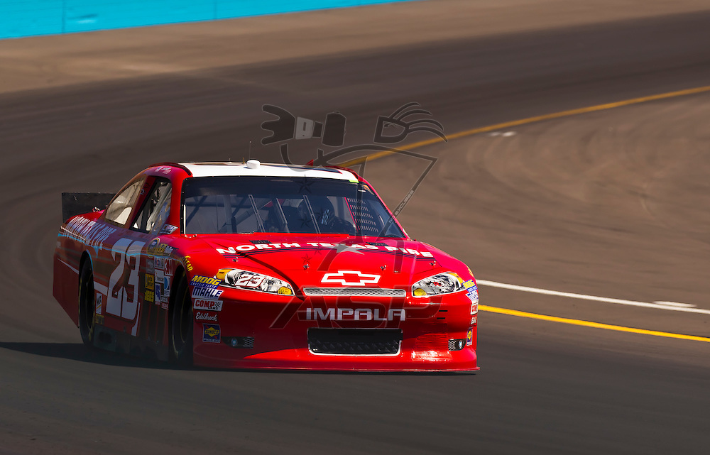 AVONDALE, AZ - MAR 03, 2012:  Scott Riggs (23) brings his NASCAR Sprint Cup car through turn 4 during qualifying for the Subway Fresh Fit 500 race at the Phoenix International Raceway in Avondale, AZ.