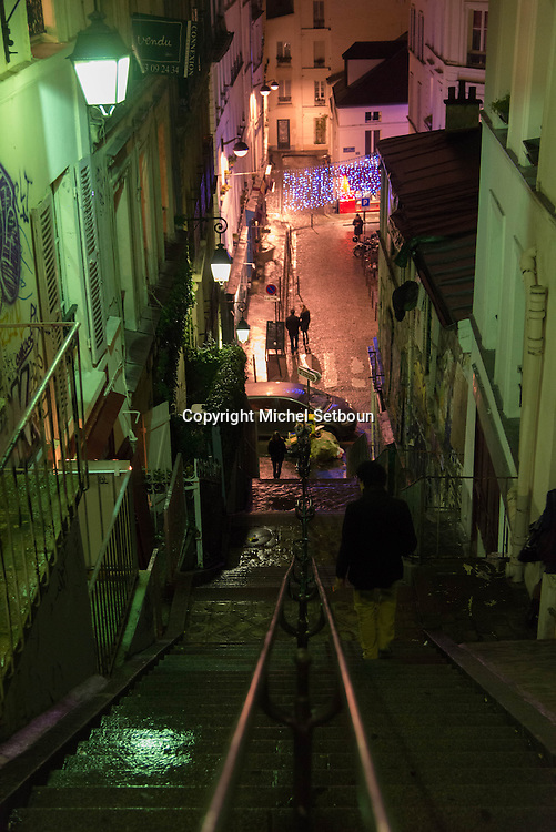 France. Paris 18th; people on Montmartre stairs, Rue drevet at night