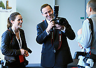 Prime Minister John Key with photographers Sandra Mu (L) and Phil Walter (R) during the One Year To Go Media Session. Countdown to the 2011 RWC, Eden Park, Auckland, Thursday 9 September 2010. Photo: Andrew Cornaga/PHOTOSPORT