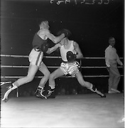 19/01/1962.01/19/1962.19 January 1962.Irish Amateur National Junior Boxing Championships..J. McCourt, (right) Immaculata Boxing Club, Belfast, lands a right jab to the body of J. Clarke, St. Philomenas' Boxing Club, Dundalk, at the 2nd Series Featherweight Contest f the Irish Amateur National Junior Boxing Championships held at the National Boxing Stadium, Dublin..McCourt received a cut on the eye in the 2nd round and the referee stopped the contest in favour of Clarke.