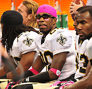 "New Orleans Saints CB Randall Gay 20 is styling in his onk cap and sunglassses with link antiglare tape under his eyes and oink gloves and pink wrist band while he catches his breath on the bench during the game against the carolina Panthers Sunday Oct. 3,2010. The NFL has gone ""Pink"" for October in honor of Breast Cancer Awareness. The Saints went on to win 16-14. John Carney kicked three field goals to help the Saints win. PHOTO©SuziAltman.com"