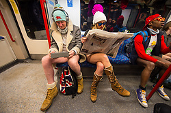 People ride on a London Underground train as they take part in No Trousers on the Tube day, in London.