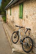 Bicycle and weathered wall, Northern Velebit National Park, Croatia