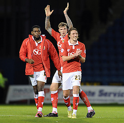 Bristol City's Luke Ayling and Bristol City's Aden Flint applaud the away support after a 1 - 2 victory - Photo mandatory by-line: Dougie Allward/JMP - Mobile: 07966 386802 - 08/11/2014 - SPORT - Football - Gillingham - Priestfield Stadium - Gillingham v Bristol City - FA Cup - Round One