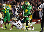 Oregon linebacker Tony Washington (91) tries to recover the fumble from Florida State quarterback Jameis Winston (5) during the second half. The No. 2 Oregon Ducks play the No. 3 Florida State Seminoles at the Rose Bowl Stadium in Pasadena, California on January 1, 2015. (Ryan Kang/Emerald)