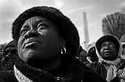 While standing on the National Mall with over a million others, Dana Pryor-Moncrieffe of Buffalo tears up as Barack Obama is sworn in as the 44th President of the United States in Washington DC on Tuesday, January 20, 2009.