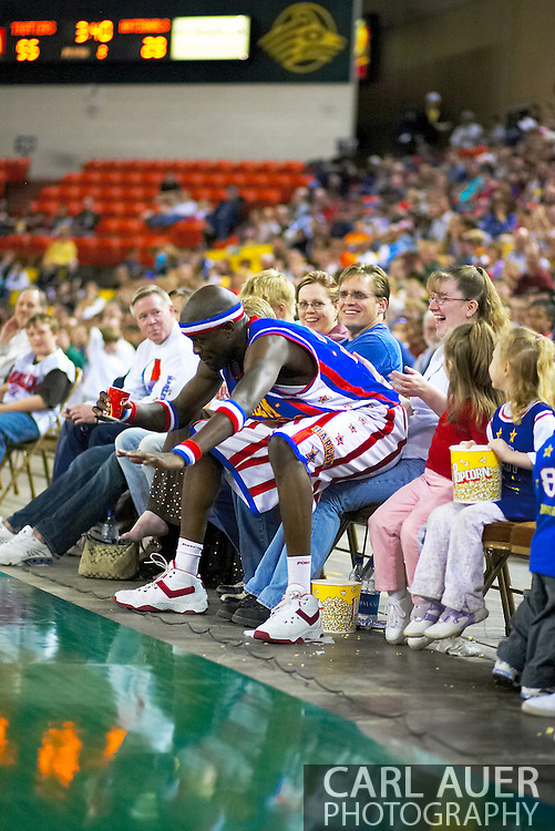 "04 May 2006: Kevin ""Special K"" Daley takes a seat on a fan at the Harlem Globetrotters vs the New York Nationals at the Sulivan Arena in Anchorage Alaska during their 80th Anniversary World Tour.  This is the first time in 10 years that the Trotters have visited Alaska."