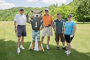 Left to right: John Kotowski, Tom Kotowski, Jeff Bowlus, and Robin Bowlus at the alumni golf outing. Photo by Lauren Pond