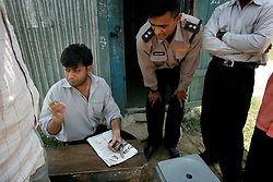 BANGLADESH HABIGANJ SHERPUR 23FEB05 - JLM assistant Rumi discusses construction plans near Sherpur bridge, northern Bangladesh...jre/Photo by Jiri Rezac ..© Jiri Rezac 2005..Contact: +44 (0) 7050 110 417.Mobile:  +44 (0) 7801 337 683.Office:  +44 (0) 20 8968 9635..Email:   jiri@jirirezac.com.Web:    www.jirirezac.com..© All images Jiri Rezac 20045- All rights reserved.