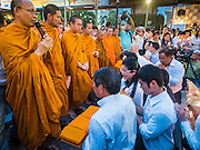 24 AUGUST 2015 - BANGKOK, THAILAND: Buddhist monks lead a memorial service for victims of the Erawan Shrine bombing at the shrine Monday. One week after the a bomb at the Erawan Shrine in the center of Bangkok killed dozens and hospitalized scores of people, police have not made any arrests. Police bomb sniffing dogs have been deployed to malls and markets around Bangkok. There was a large memorial service sponsored by businesses close the bomb site Monday evening.    PHOTO BY JACK KURTZ