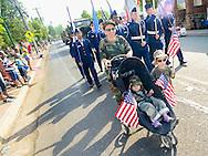 From left, Lana Leggett pushes Valerie Leggett 2, in a stroller as Joel Leggett, 4, walks alongside during the Hatfield Memorial Day Parade Monday May 25, 2015 in Hatfield, Pennsylvania. (Photo by William Thomas Cain/Cain Images)