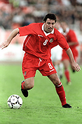 MINSK, BELARUS - Saturday, September 4, 1999: Wales's Dean Saunders in action against Belarus during the UEFA Euro 2000 Qualifying Group One match at the Dinamo Stadium. (Mandatory credit: David Rawcliffe/Propaganda)