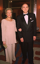 PRINCE & PRINCESS DIMITRI ROMANOV at a reception in London on 16th March 1998.MGB 5