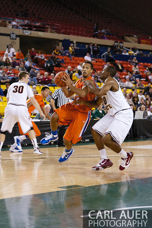 November 25th, 2010:  Anchorage, Alaska - Houston Baptist guard, Miles Dixon (5) drives to the hoop in the Huskies 55-73 loss to Arizona State in a first round game of the Great Alaska Shootout.