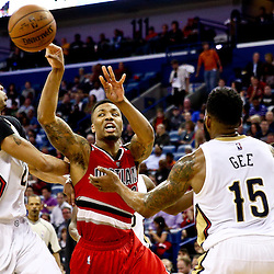Mar 18, 2016; New Orleans, LA, USA; Portland Trail Blazers guard Damian Lillard (0) loses the ball as New Orleans Pelicans forward Anthony Davis (23) and forward Alonzo Gee (15) defend during the second quarter of a game at the Smoothie King Center. Mandatory Credit: Derick E. Hingle-USA TODAY Sports
