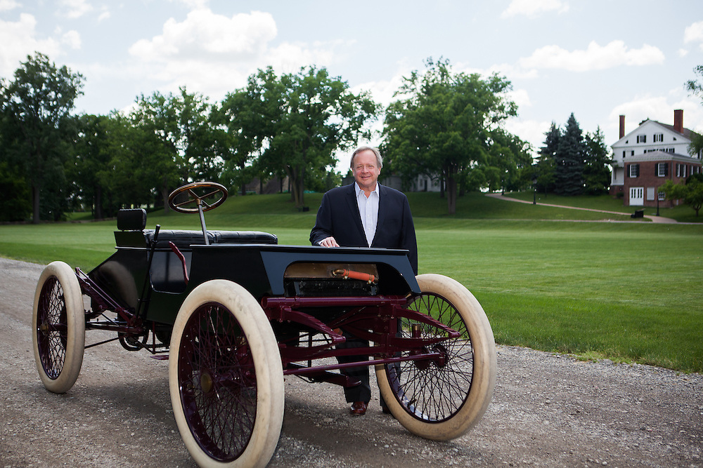 Edsel Ford II standing next to Henry Ford's first race car Sweepstakes.  Photographed for Ford Racing by KMS Photography
