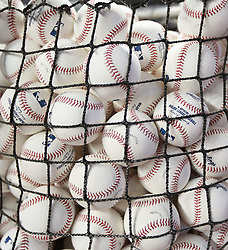 April 10, 2017 - Miami, FL, USA - Baseballs in a basket during batting practice before the start of the Miami Marlins' home opener, against the Atlanta Braves, at Marlins Park in Miami on Tuesday, April 11, 2017. (Credit Image: © David Santiago/TNS via ZUMA Wire)
