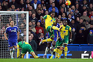 Dieumerci Mbokani of Norwich clears the ball during the Barclays Premier League match at Stamford Bridge, London<br /> Picture by Paul Chesterton/Focus Images Ltd +44 7904 640267<br /> 21/11/2015