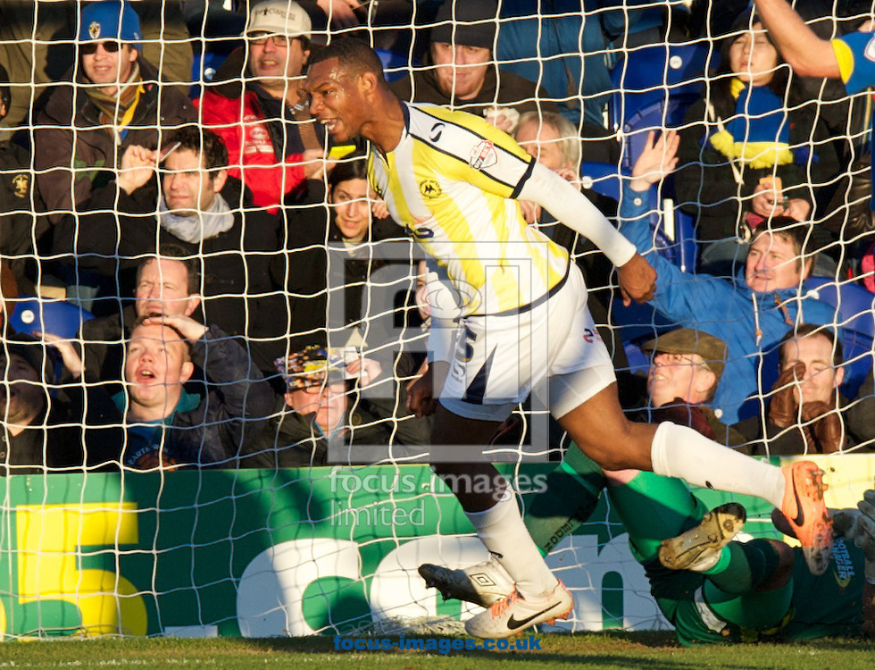 Picture by Alan Stanford/Focus Images Ltd +44 7915 056117<br /> 11/01/2014<br /> Krystian Pearce (5) of Torquay United celebrates after scoring the opening goal during the Sky Bet League 2 match at the Cherry Red Records Stadium, Kingston.