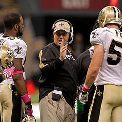 2009 October 04: New Orleans Saints defensive coordinator Gregg Williams (center) talks to his squad during 24-10 win by the New Orleans Saints over the New York Jets at the Louisiana Superdome in New Orleans, Louisiana.