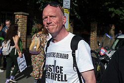 London, UK. 14th June, 2018. Matt Wrack, General Secretary of the Fire Brigades Union, arrives to take part in the Grenfell Silent March through West Kensington on the first anniversary of the Grenfell Tower fire. 72 people died in the Grenfell Tower fire and over 70 were injured.