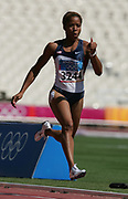 LaTasha Colander of the United States wins first-round heat of the women's 100 meters in 11.31 in the 2004 Olympics in Athens, Greece on Friday, August 20, 2004.