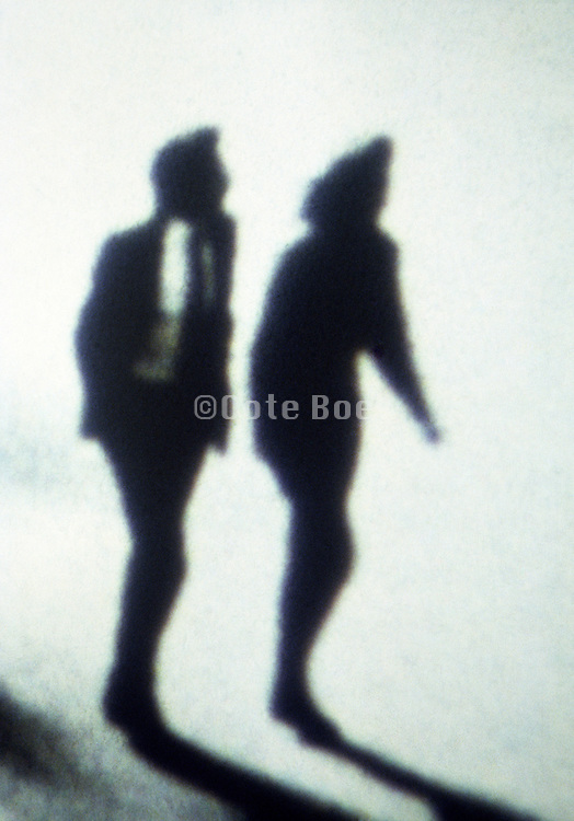 Silhouette of a couple walking