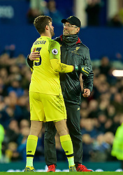 LIVERPOOL, ENGLAND - Sunday, March 3, 2019: Liverpool's manager Jürgen Klopp embraces goalkeeper Alisson Becker after the FA Premier League match between Everton FC and Liverpool FC, the 233rd Merseyside Derby, at Goodison Park. The game ended in a 0-0 draw. (Pic by Paul Greenwood/Propaganda)