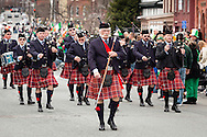 Goshen, New York - The Firefighter McPadden Pipes and Drums of the Goshen Emerald Society march on Main Street during the 40th annual Mid-Hudson St. Patrick's Parade on March 13, 2016.