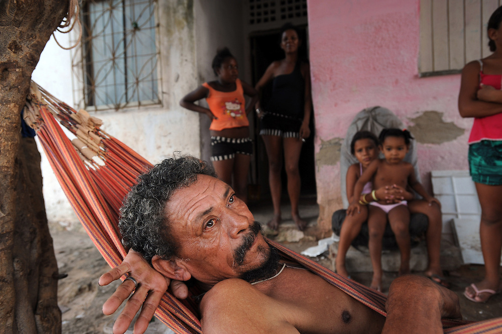 An elderly man who used to live by the beach but has been moved to make way for development, lies in a hammock in Fortaleza. Ceasa province, Brazil.PHOTO: KIM HAUGHTON 20/02/08