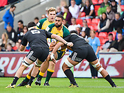 Australia second-row Lukhan Lealaiaulolo-Tui drives into the New Zealand defence during the World Rugby U20 Championship 5rd Place play-off  match Australia U20 -V- New Zealand U20 at The AJ Bell Stadium, Salford, Greater Manchester, England on Saturday, June  25  2016.(Steve Flynn/Image of Sport)