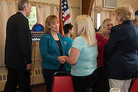 Governor Hassan and Wendy Mills share a moment following Thursday morning's kickoff event at St James Church for the Boys and Girls Club of Laconia.  (Karen Bobotas/for the Laconia Daily Sun)