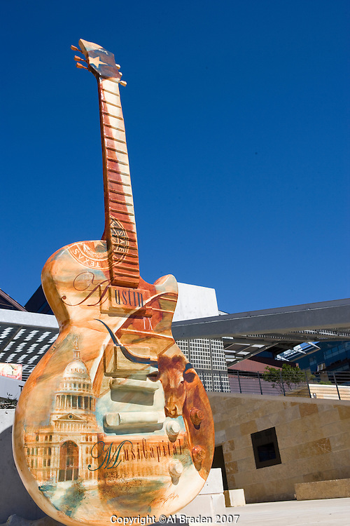MusiCapital Guitar painted for City Hall Plaza display by artist Sharon Roy Finch features Willie Nelson.