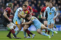 Saracens Full Back (#15) Chris Wyles is tackled by Northampton Inside Centre (#12) Dom Waldouck during the first half of the match - Photo mandatory by-line: Rogan Thomson/JMP - Tel: Mobile: 07966 386802 30/12/2012 - SPORT - RUGBY - stadiummk - Milton Keynes. Saracens v Northampton Saints - Aviva Premiership.