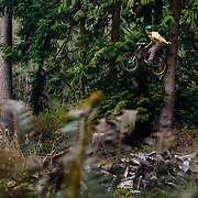 Zaid Elgawarsha takes off for a hands free air on a private trail in Bellingham Washington.